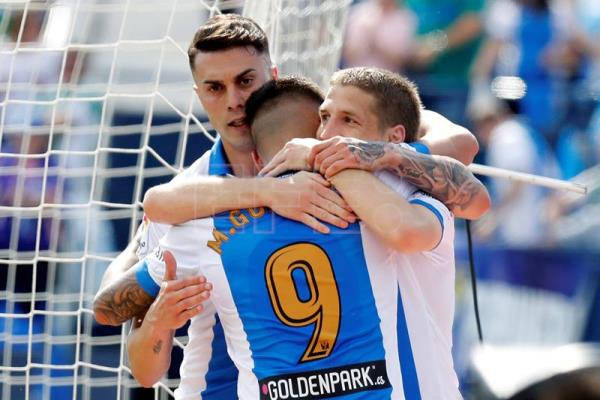 Leganes forward Jose Naranjo (L) celebrates with his teammates after giving his team a 2-1 lead during a La Liga soccer match held Leganes and Real Betis at Butarque Stadium in Madrid, Spain, May 19, 2018. EPA-EFE/Juan Carlos Hidalgo