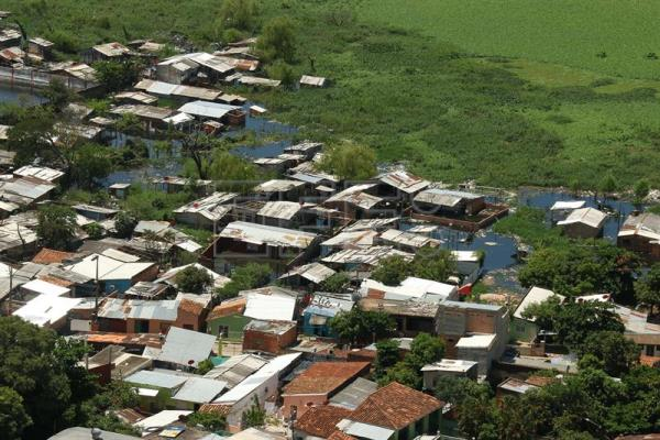 Flooding in Paraguay forces thousands from their homes