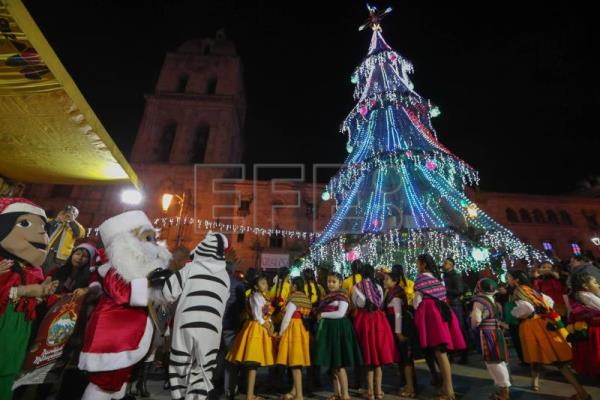 People participate during the inauguration of the Christmas decoration in La Paz, Bolivia, Dec