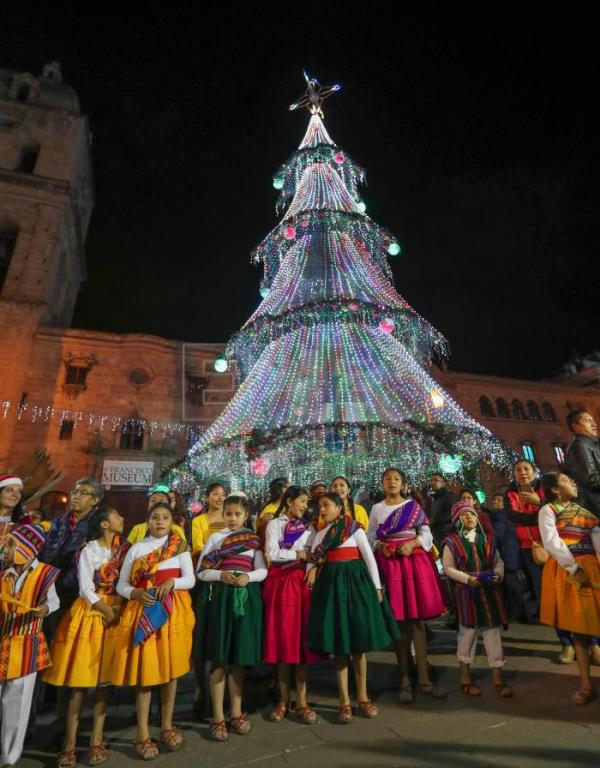 People participate during the inauguration of the Christmas decoration in La Paz, Bolivia, 10