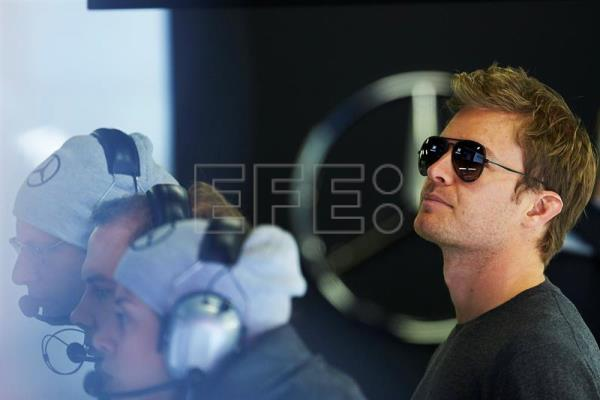 Former German Formula One driver Nico Rosberg (R) attends the Formula One pre-season test sessions at the Circuit de Barcelona-Catalunya in Montmelo, near Barcelona, northern Spain, Mar. 1, 2017. EPA/ALEJANDRO GARCIA