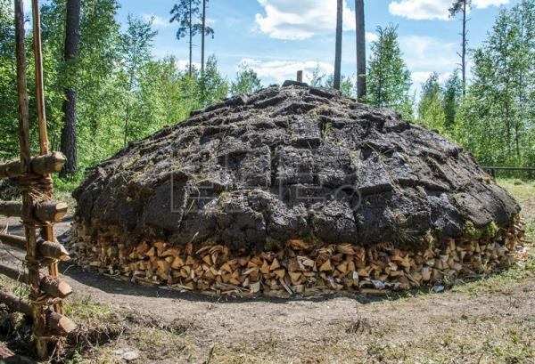 A peat covered pine tar pit is ready to be set on fire on the grounds of the Yli-Kirra Outdoor Agricultural Museum in Punkalaidun, Finland, June 27, 2017. EPA/MARKKU OJALA