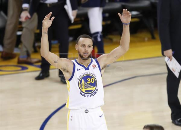 ffdf3b478150 Golden State Warriors guard Stephen Curry (C) reacts after a three point  basket is