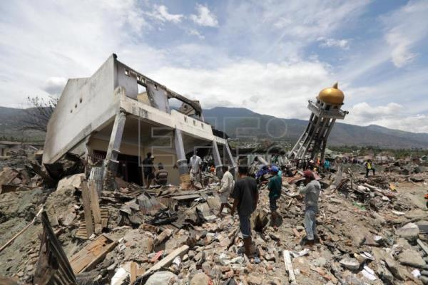 At least 5,000 missing after devastating earthquake, tsunami in
