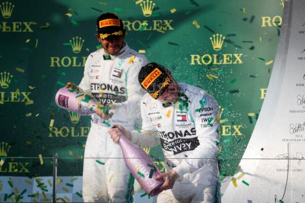 Second placed British Formula One driver Lewis Hamilton (L) of Mercedes AMG GP sprays champagne onto winner Finnish Formula One driver Valtteri Bottas (R) of Mercedes AMG GP at the end of the 2019 Formula One Grand Prix of Australia at the Albert Park Grand Prix Circuit in Melbourne, Australia, Mar. 17, 2019. EPA-EFE/DIEGO AZUBEL