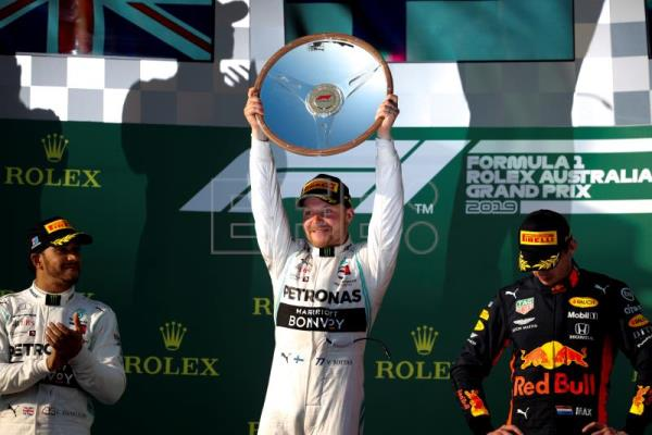 Finnish Formula One driver Valtteri Bottas (C) of Mercedes AMG GP lifts the winners trophy next to second placed British Formula One driver Lewis Hamilton (L) of Mercedes AMG GP and third placed Dutch Formula One driver Max Verstappen of Aston Martin Red Bull Racing at the end of the 2019 Formula One Grand Prix of Australia at the Albert Park Grand Prix Circuit in Melbourne, Australia, Mar. 17, 2019. EPA-EFE/DIEGO AZUBEL