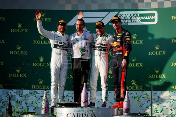 Mercedes Team Engineer Loic Serra, British Formula One driver Lewis Hamilton of Mercedes AMG GP, Finnish Formula One driver Valtteri Bottas of Mercedes AMG GP and Dutch Formula One driver Max Verstappen of Aston Martin Red Bull Racing stand on the podium at the end of the 2019 Formula One Grand Prix of Australia at the Albert Park Grand Prix Circuit in Melbourne, Australia, Mar. 17, 2019. EPA-EFE/DIEGO AZUBEL