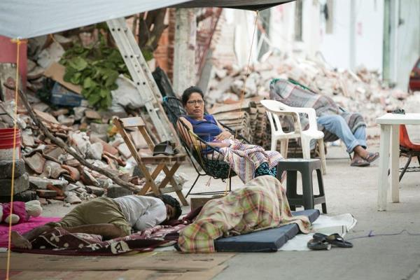 Residents sleep in the city's streets and plazas after last week's earthquake partially or completely destroyed their dwellings, in Juchitan de Zaragoza, Oaxaca, Mexico on Sept. 13, 2017. EPA-EFE/Mario Arturo Martinez