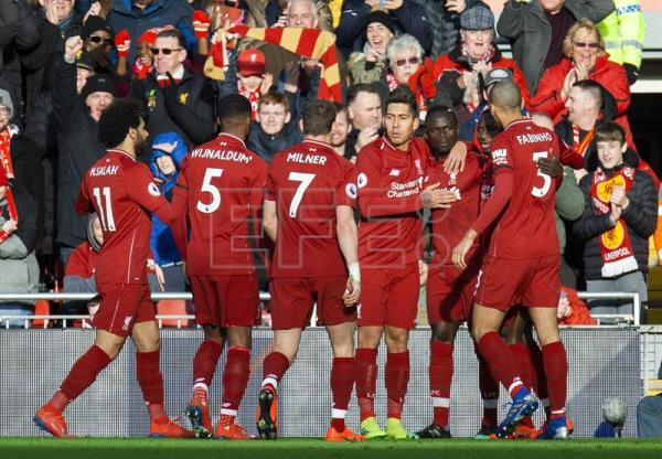 Liverpool thrash Bournemouth 3-0, regain Premier League lead