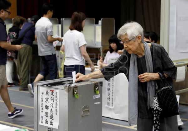 Japan's Abe wins upper house election, falls short of majority for reform
