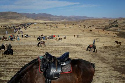 Blanket clad tribesmen gather for king's birthday horse racing in Lesotho