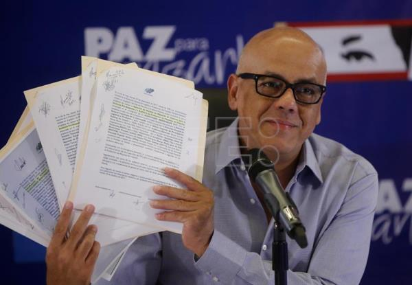 A handout photo made available by the Venezuelan News Agency shows the head of the elections division of the United Socialist Party (PSUV) Jorge Rodriguez during a press conference, in Caracas, Venezuela, 16 October 2017. EPA-EFE/Venezuelan News Agency HANDOUT HANDOUT EDITORIAL USE ONLY/NO SALES