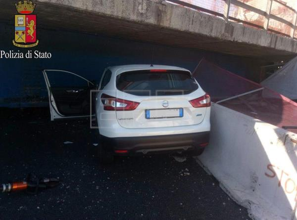A handout photo made available by the Italian State Police (Polizia di Stato) on 09 March 2017 shows a car crushed by parts of a bridge that collapsed and fell onto the A14 motorway near the central Italian city of Ancona, 09 March 2017, killing at least two people and injuring two others. The dead people were in a car that was just under the bridge when it collapsed. The Italian highway company Autostrade per l'Italia said that the bridge was a temporary structure to support an overpass that had been closed to traffic. The collapse took place amid work to broaden the highway between the South Ancona and Loreto exits to three lanes. Only one car was affected by the collapse, the one in which the dead people were travelling, according to an initial reconstruction.  EPA/POLICE PRESS OFFICE HANDOUT  HANDOUT EDITORIAL USE ONLY/NO SALES