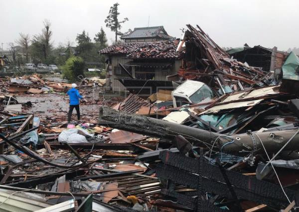 A man walks through debris of damaged houses by a tornado caused by typhoon Hagibis in Ichihara, Chiba Prefecture, east of Tokyo, Oct. 12, 2019. EFE-EPA/JIJI PRESS JAPAN