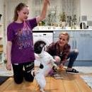Magdalena Piszczek (R) and her daughter Olivia, pose for a portrait with their Jack Russel dog 'Tiny' in Wembley in London, Britain, 26 February 2019. EPA-EFE/NEIL HALL
