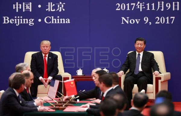China us sign trade agreements worth 2535 billion world us president donald trump l and his chinese counterpart xi jinping r platinumwayz