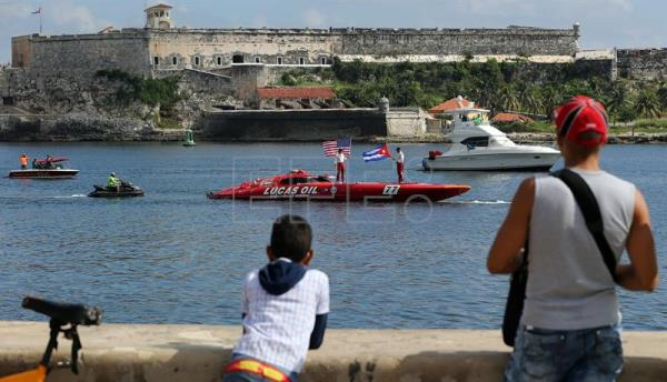 Nigel Hook (R) and Jay Johnson (L), drivers of the speedboat Lucas Oil SilverHook, are seen in Havana Harbor, Cuba, after making the journey from Key West, Florida, to Havana in a record time of one hour and 18 minutes on 17 August 017. EFE/Alejandro Ernesto