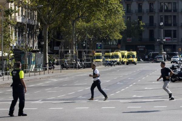 Security forces members at the scene where a van hit pedestrians in Barcelona, Spain, Aug. 17, 2017. EFE/QUIQUE GARCIA