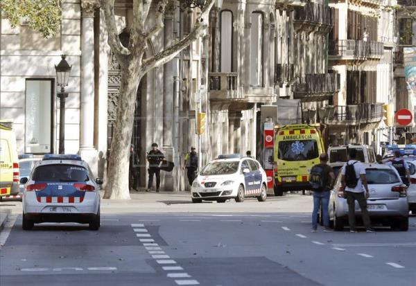 Police and emergency services at the scene where a van hit pedestrians in Barcelona, Spain, Aug. 17, 2017. EFE/ANDREU DALMAU