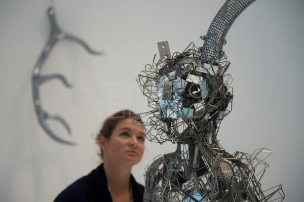 "A gallery employee views the sculpture ""Titan"" at the Hayward Gallery, London, Britain, May 29, 2018. EPA-EFE/Ben Stevens"