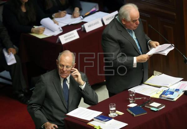 Peruvian President Pedro Pablo Kuczynski (L), accompanied by his lawyer Alberto Borea (R) attends an impeachment hearing at the Congress, in Lima, Peru, Dec. 21, 2017. EPA-EFE FILE/ERNESTO ARIAS