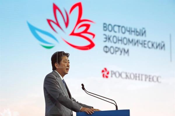 Japanese Prime Minister Shinzo Abe delivers his speech during the main plenary session of the Eastern Economic Forum on Russky Island in Vladivostok, Russia, Sep. 12, 2018. EPA-EFE/SERGEI CHIRIKOV