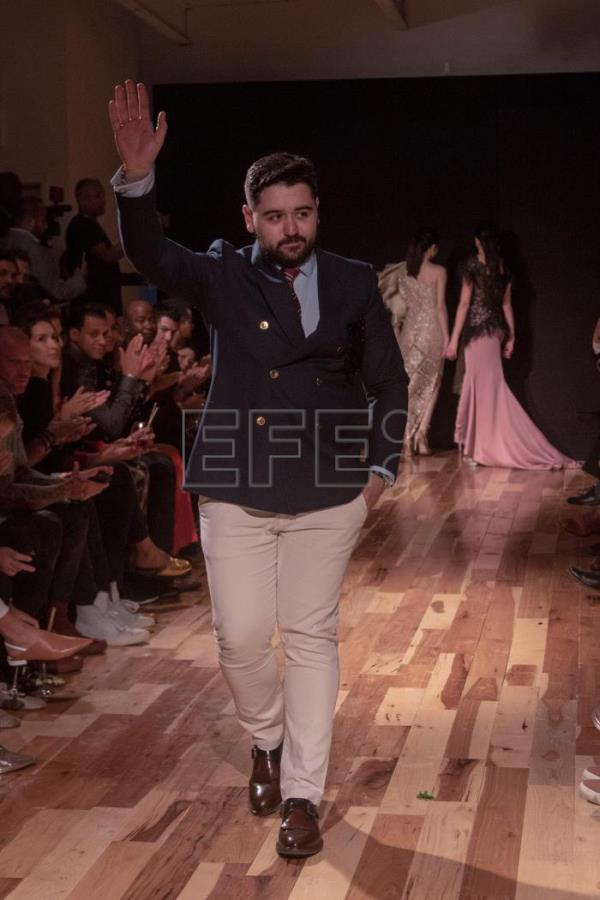 The Spanish designer Francisco Saez, greets the audience on Tuesday, Sep 11, 2018, after presenting his new collection in New York (United States), during New York Fashion Week. EFE-EPA/Miguel Rajmil