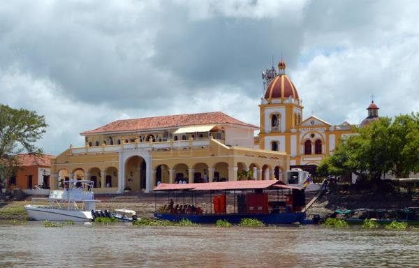 Photograph provided Sept. 12 showing a view of the Church of the Immaculate Virgin (r) and the pier in Mompox, Colombia, Sept 8, 2018. EPA-EFE/Juan Carlos Gomi