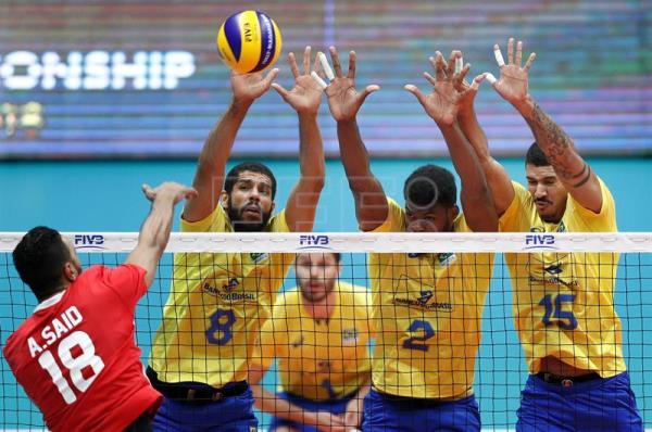 Egypt's Ahmed Shafik (L) in action against Brazil's Wallace De Souza (2L), Isac Santos (2R) and Carlos Eduardo Barreto Silva (R) during a Volleyball Men's World Championship Pool B match between Brazil and Egypt in Ruse, Bulgaria, 12 September 2018. EPA-EFE/ROBERT GHEMENT