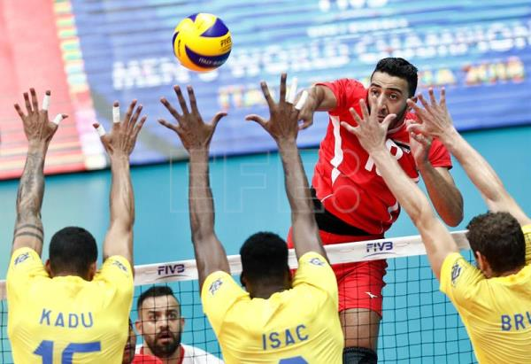 Egypt's Ahmed Shafik (R, in red) spikes the ball as three Brazilian players - captain Bruno Rezende (R), Isac Santos (C) and Carlos Eduardo Barreto Silva - go up for the block during a Volleyball Men's World Championship Pool B match in Ruse, Bulgaria, 12 September 2018. EPA-EFE/ROBERT GHEMENT