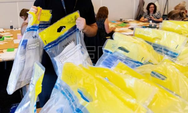 Election officials count parliamentary ballot papers at a tally centre in Malmo, Sweden, 11 September, 2018. EPA/JOHAN NILSSON