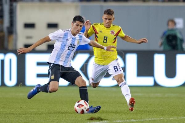Colombia midfielder Gustavo Cuellar (R) in action against Argentina midfielder Exequiel Palacios (L) during the first half of the friendly match between the national teams of the Colombia and Argentina at MetLife Stadium in East Rutherford, New Jersey, USA, Sep. 11, 2018. EPA-EFE/COREY SIPKIN