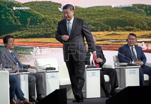 Japanese Prime Minister Shinzo Abe (L), Chinese President Xi Jinping (2-L), Russian President Vladimir Putin (C) and Mongolian President Khaltmaagiin Battulga (R) attend a main plenary session of the Eastern Economic Forum on Russky Island in Vladivostok, Russia, Sep. 12, 2018. EPA-EFE/SERGEI CHIRIKOV