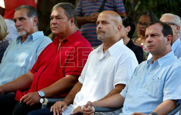 Rene Gonzalez (L), Ramon Labañino (2-L), Gerardo Hernandez (C-R), and Fernando Gonzalez (R), four of the 'Cuban Five', attend an event to mark the 20th anniversary of their arrest, Havana, Cuba, Sept. 12, 2018. EPA-EFE/Ernesto Mastrascusa