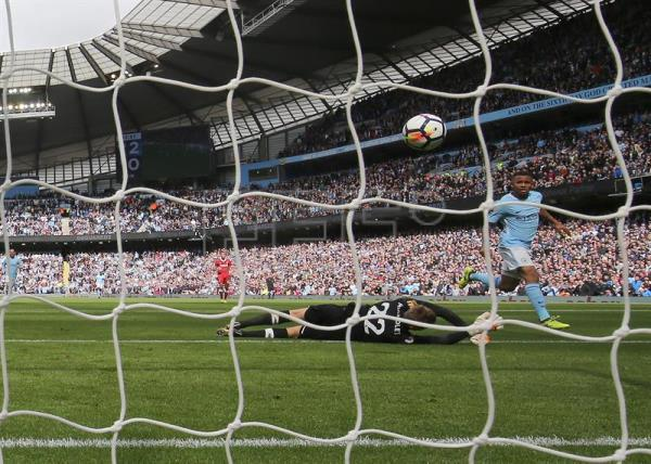 Manchester city thrash 10 man liverpool 5 0 outstanding english manchester citys gabriel jesus r shoots to score a goal during the english premier voltagebd Image collections