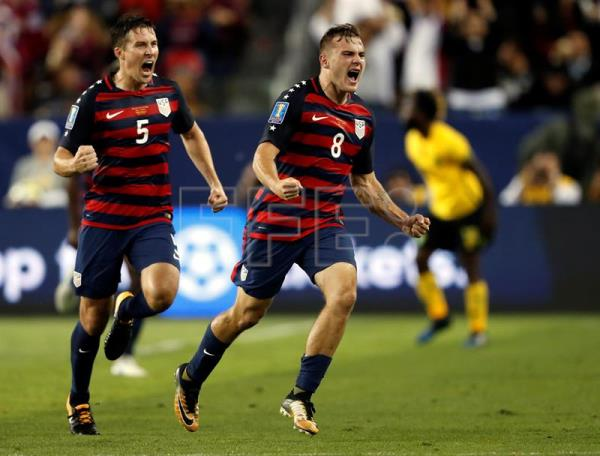 8bc10debe5e US captures sixth Gold Cup title. US national team forward Jordan Morris  (C) celebrates with teammate Matt Besler (L) after scoring the winning goal  ...