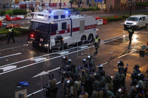 Hong Kong police deploy water cannons at protests
