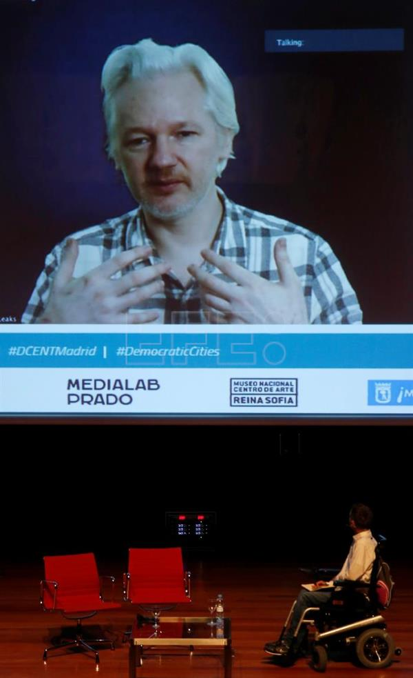 Madrid's Councilor for Transparency, Citizen Participation and Open Government, Pablo Soto listens to WikiLeaks founder Julian Assange while speaking via videoconference during the conference on 'Democratic Cities' held at the Reina Sofia Museum in Madrid, Spain on May 27, 2016. EFE