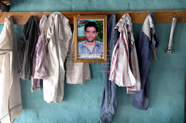 A photo of the 19 year old farmer Mukesh Yadav, who committed suicide on May 15, 2017 by consuming pesticide, hangs on the wall of his residence in Lachur village in Sehore Madhya Pradesh, India, May 19, 2018. EPA-EFE/HARISH TYAGI ATTENTION: For the full PHOTO ESSAY text please see Advisory Notice epa06803807