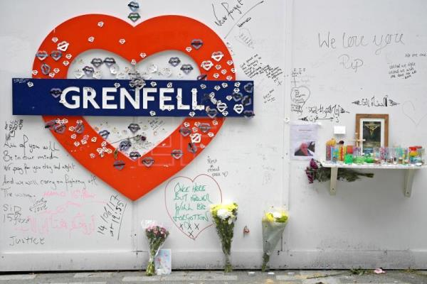 Tributes to the victims of the Grenfell Tower fire are displayed in London, Britain, 13 June 2018, on the eve of the tragedy's first anniversary. EPA-EFE/NEIL HALL
