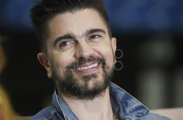 Colombian singer Juanes smiles during a joint press conference with Dominican Vicente Garcia (a recording artist who will be the Colombian's opening act at a 15 June 2018 concert) at the Jose Miguel Agrelot Coliseum in San Juan, Puerto Rico, 13 June 2018. EPA-EFE/Thais Llorca