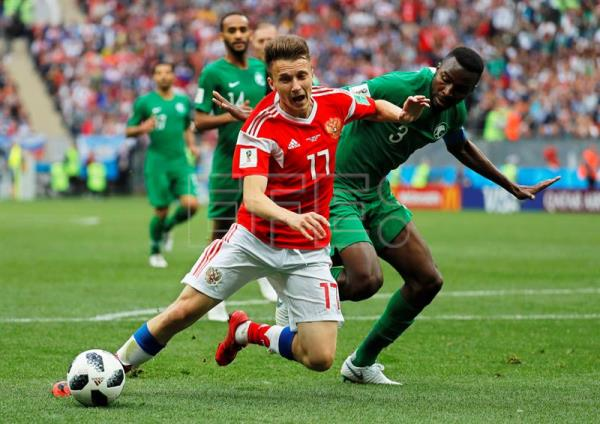 Aleksandr Golovin (L) of Russia in action against Osama Hawsawi (R) of Saudi Arabia during the FIFA World Cup 2018 group A preliminary round soccer match between Russia and Saudi Arabia in Moscow, Russia, 14 June 2018. EFE