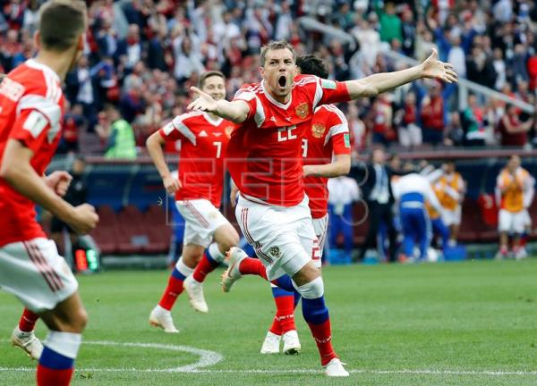 Artem Dzyuba of Russia celebrates after scoring the 3-0 goal during the FIFA World Cup 2018 group A preliminary round soccer match between Russia and Saudi Arabia in Moscow, Russia, 14 June 2018. EFE
