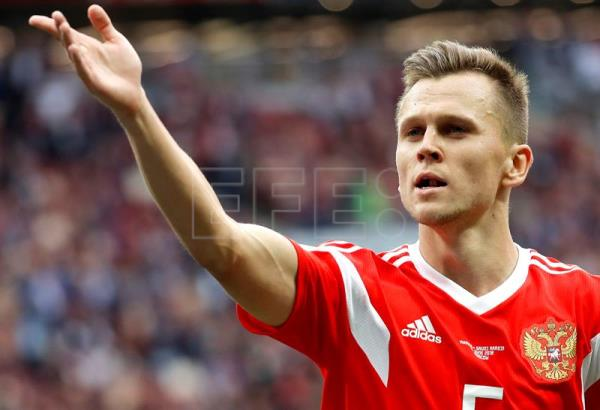 Denis Cheryshev of Russia celebrates after scoring the 4-0 during the FIFA World Cup 2018 group A preliminary round soccer match between Russia and Saudi Arabia in Moscow, Russia, 14 June 2018. EFE