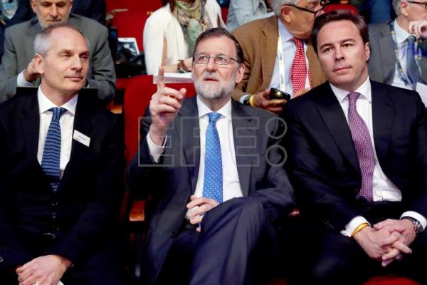 Spain's ex-prime minister Mariano Rajoy (C) sits next to World Retail Congress Founder and President, British Ian McGarrigle (L), and ousted El Corte Ingles president Dimas Gimeno (R), during the opening of the 12th World Retail Congress in Madrid, Spain, Apr. 17 2018. EPA-EFE/FILE/CHEMA MOYA