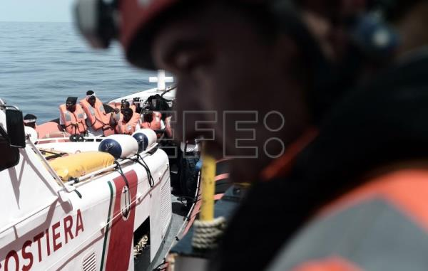 A handout photo made available by NGO 'SOS Mediterranee' on 12 June 2018 shows some of the 629 migrants boarding rescue vessel 'Aquarius' in the Mediterranean. EPA-EFE/KENNY KARPOV/SOS MEDITERRANEE