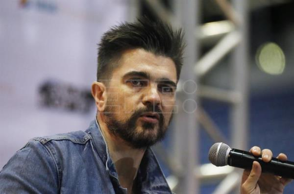 Colombian singer Juanes poses during a joint press conference with Dominican singer Vicente Garcia (who will be the Colombian's opening act at a 15 June 2018 concert in San Juan) at the Jose Miguel Agrelot Coliseum in San Juan, Puerto Rico on 13 June 2018. EPA-EFE/THAIS LLORCA