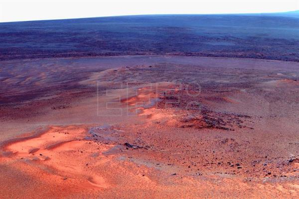 A handout image provided by NASA on 25 January 2012 is a mosaic of images taken in mid-January 2012 showing the windswept vista northward (L) to northeastward (R) from the location where NASA's Mars Exploration Rover 'Opportunity' is spending its fifth Martian winter, an outcrop informally named 'Greeley Haven.' The Mars rover's Panoramic Camera (Pancam) took the component images as part of a full-circle view being assembled from 'Greeley Haven'. The view includes sand ripples and other wind-sculpted features in the foreground and mid-field.  EPA-EFE/FILE/NASA HANDOUT EDITORIAL USE ONLY