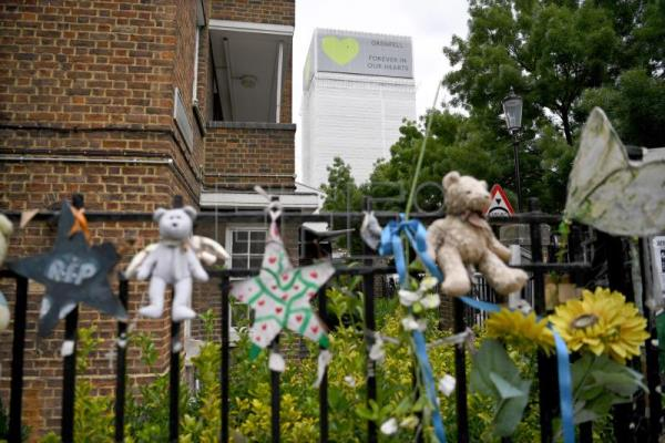 Tributes to the Grenfell Tower fire are displayed in London, Britain, 13 June 2018, on the eve of the tragedy's first anniversary. EPA-EFE/NEIL HALL
