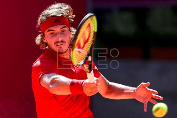 Joao Sousa of Portugal in action against Greece's Stefanos Tsitsipas during their semi final match of the Estoril Open tennis tournament in Cascais, near Lisbon, Portugal. EFE/EPA